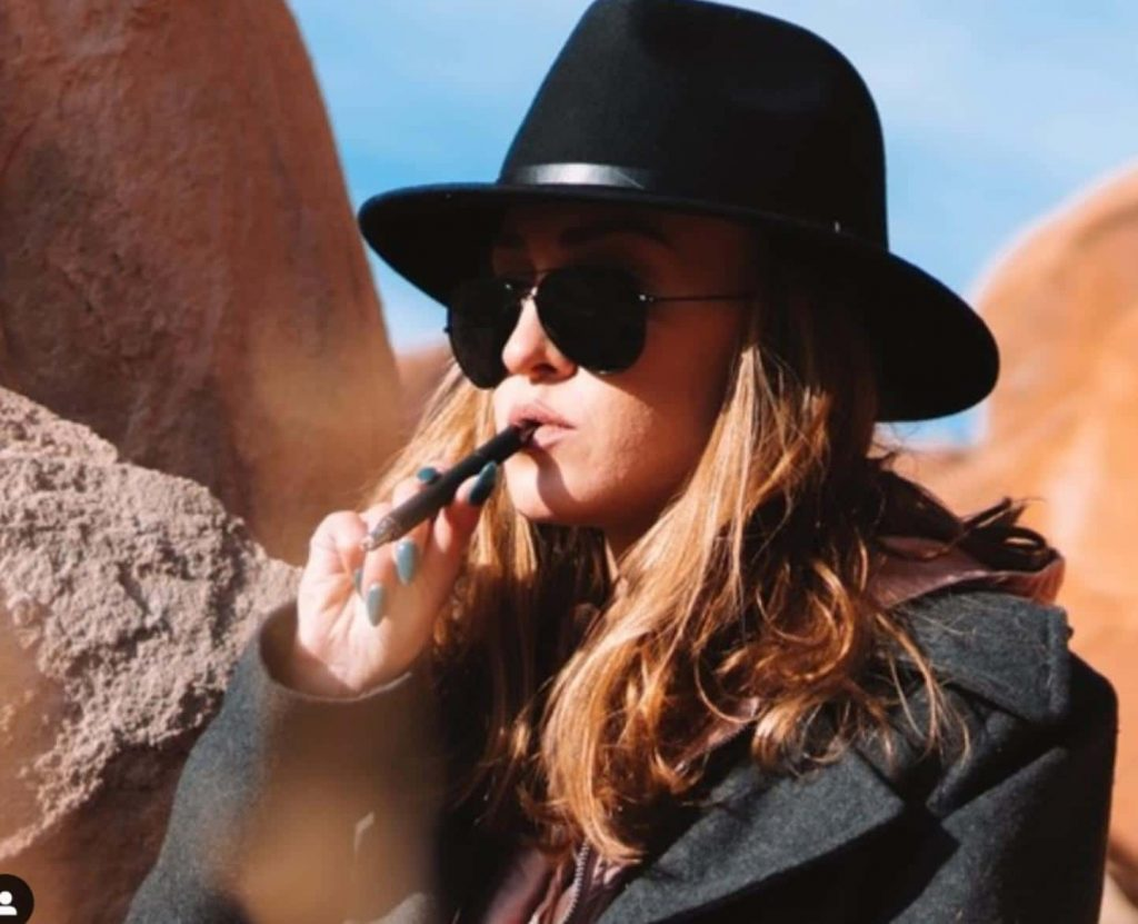 Taking a hit from the Terp Pen XL with a desert background.