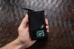 The Boundless CFX vaporizer turned on with temperature display screen illuminated.