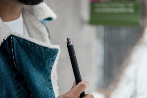 Hitting a vape pen for concentrates when on the go when a portable vaporizer is too bulky.