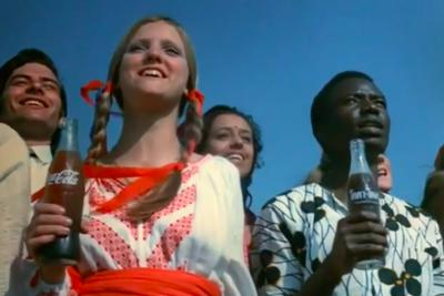 """A screenshot from the Coca Cola """"Hilltop Commercial"""" which inspired the parody """"Buy the World a Toke""""."""
