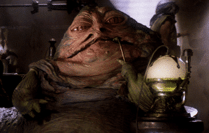 Jabba the Hutt taking a hit from a hookah style water pipe.