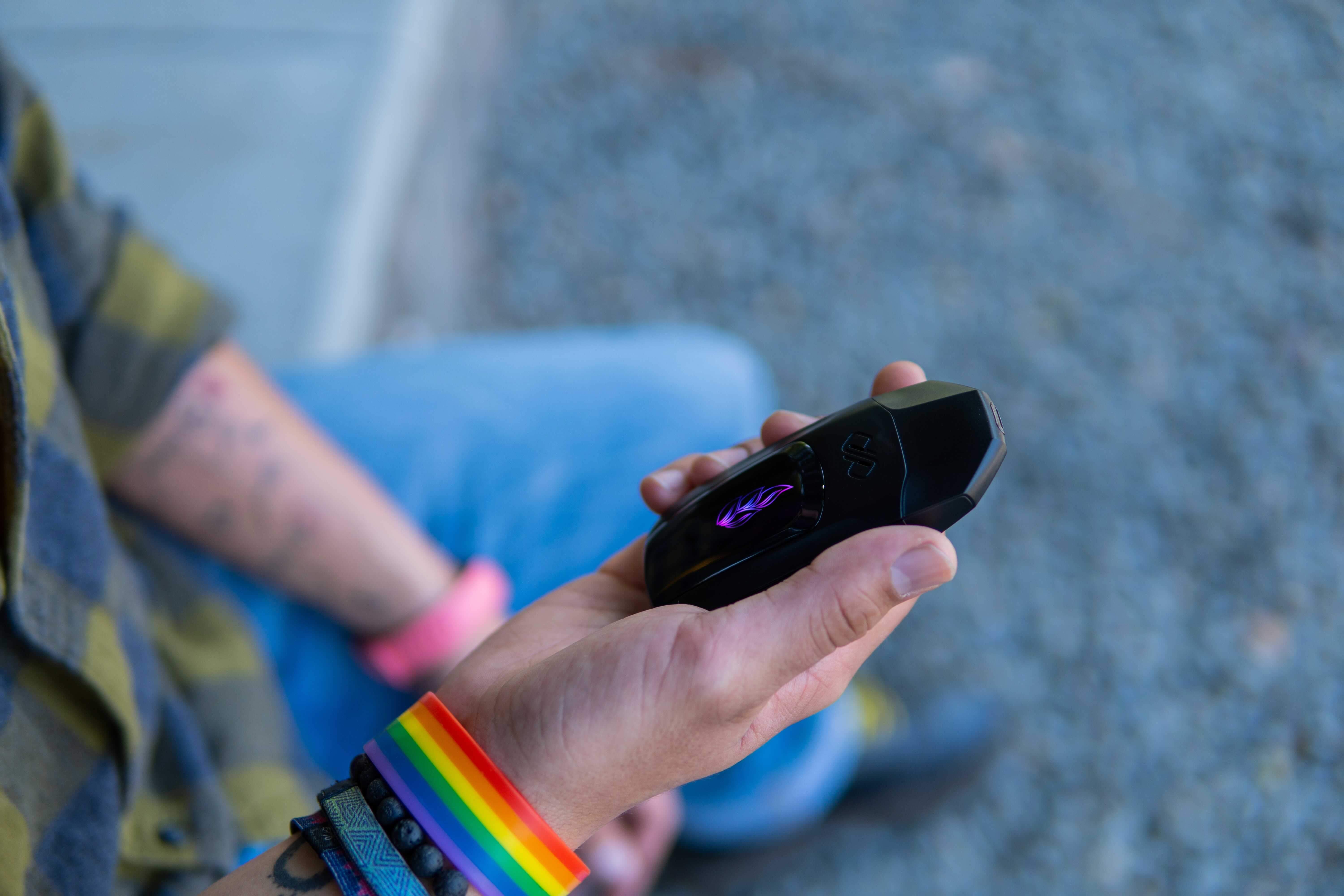 Hand Holding the Vexil Vaporizer